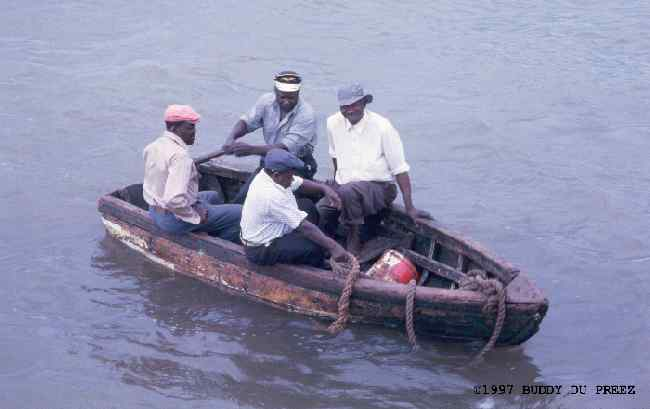 Four men in a boat �98 Buddy du Preez, all rights reserved